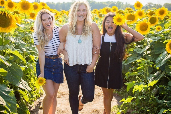 girls in a field of sunflowers